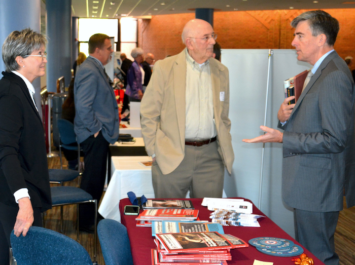 Elizabeth Bancroft at AFIO exhibit table with Ed Jacbos (NCMF treasurer) and Chris Inglis (NCMF BoD Chair).