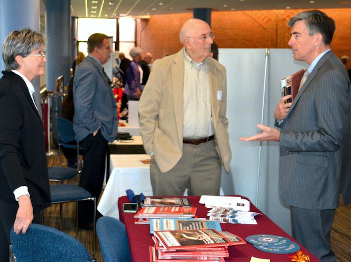 Elizabeth Bancroft at AFIO exhibit table with Ed Jacbos (NCMF treasurer) and Chris Inglis (NCMF BoD Chair).