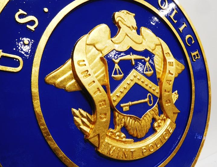 AP-4730- Carved Plaque of the Seal of the US Mint Police, Gold Leaf Gilded (close-up)