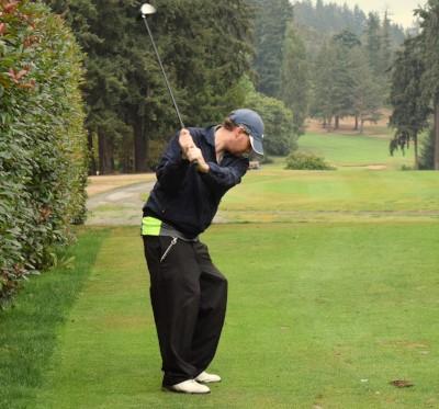 Preston swings golf club