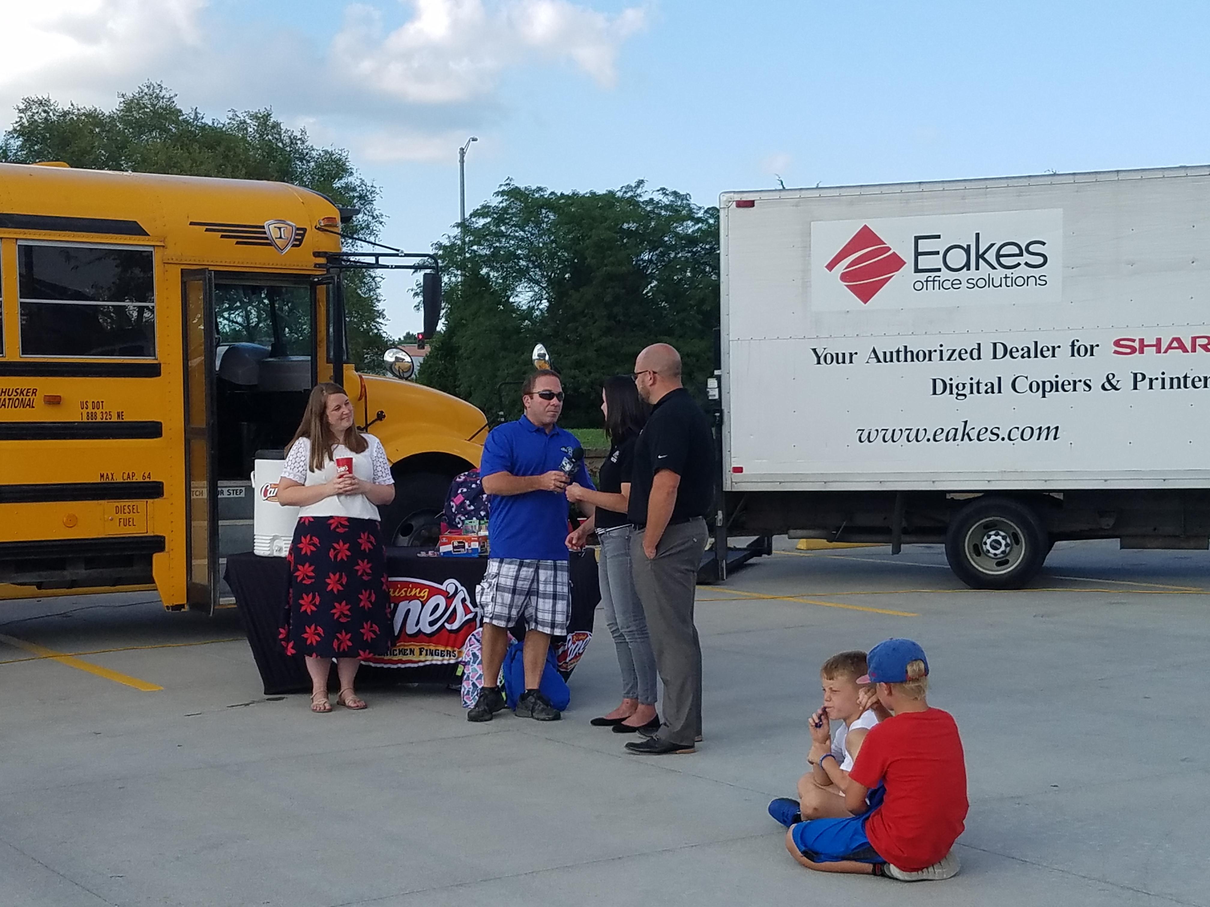 Eakes & Raising Cane's Team Up for Stuff the Bus