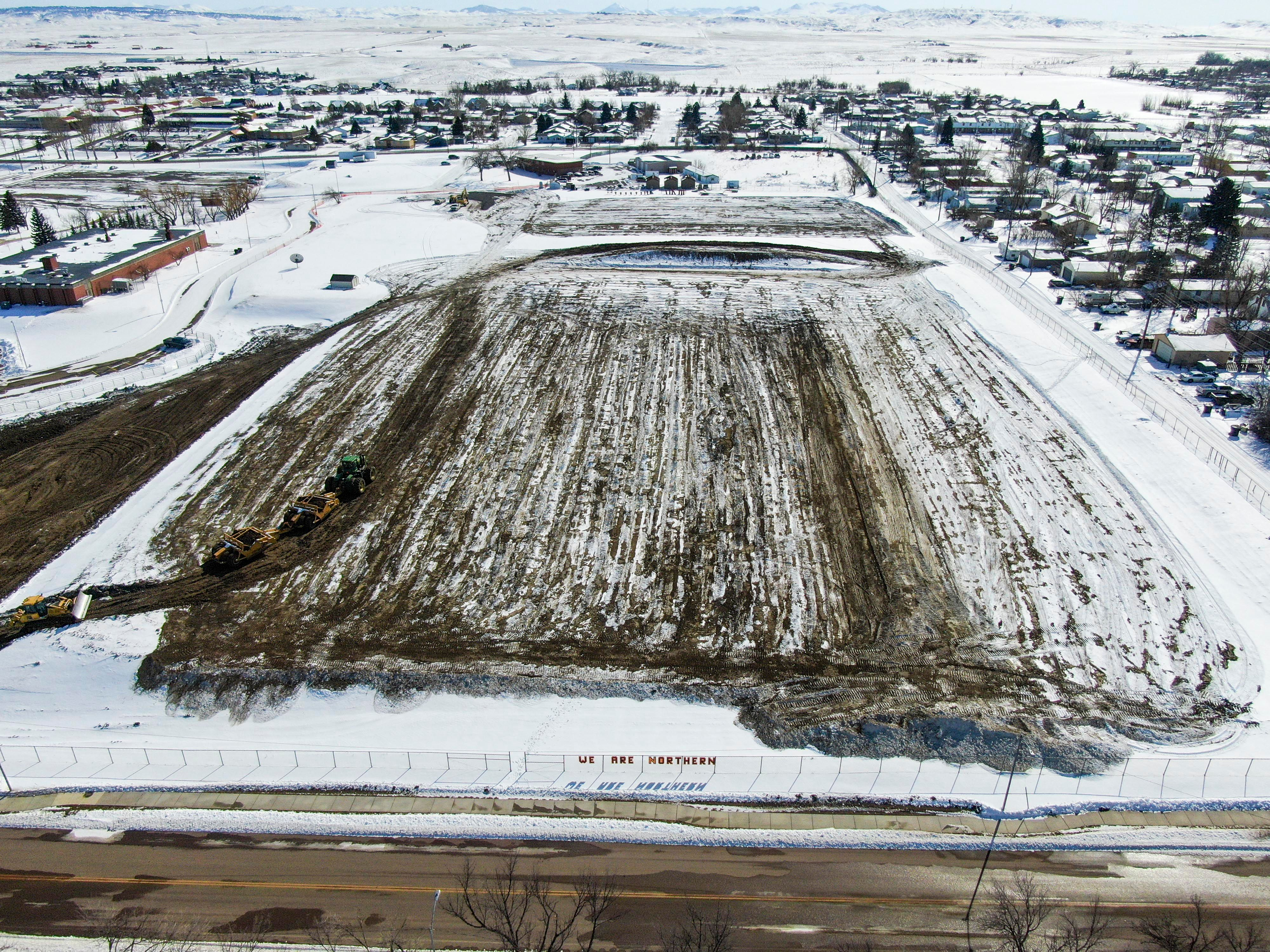 An aerial shot of the field facing South, 3/12