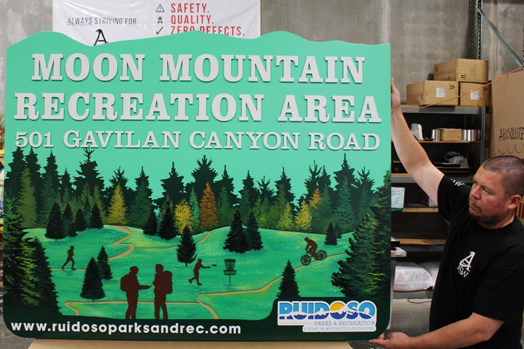 G16223 - Carved HDU Sign for the Moon Mountain Recreational Area, with Trees and Meadow as Artwork