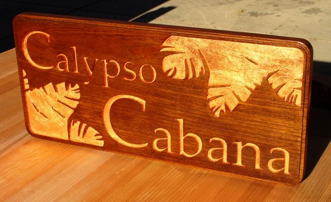 GB16837 - Engraved  and Recessed Carved Mahogany Wood Gold-Leaf Gilded  Sign for the Calypso Cabana, with  Philodendron Leaves as Artwork