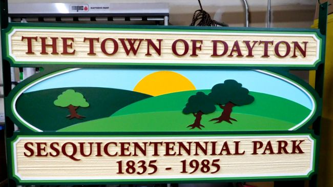 X33067 - Carved Sign featuring the Logo of the Town of Dayton, Virginia, with Hills, Trees and the Setting Sun
