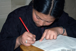 Woman learning to read and write in English