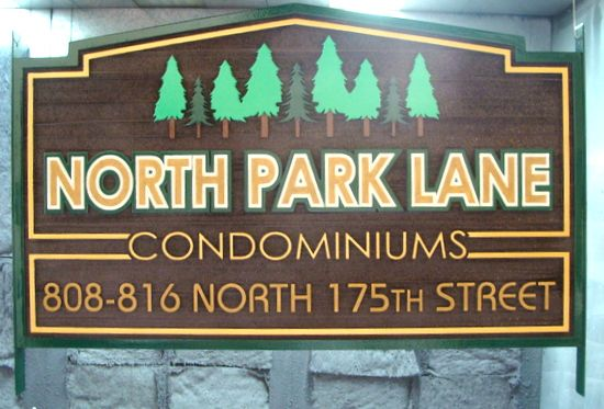 "K20154 - Carved and Sandblasted HDU Condominium Sign ""North Park Lane"" with Evergreen Trees"