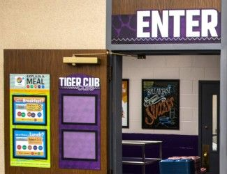 Custom Menu board options in school cafeteria, custom signs in purple with paper holder, enter sign