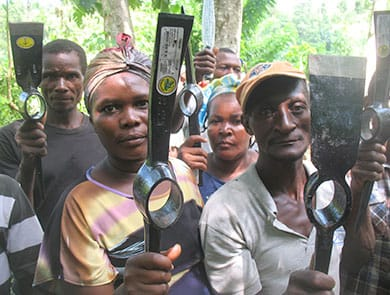 Farmers participating in the tree nursery program earn farming tools that help them increase their harvests.
