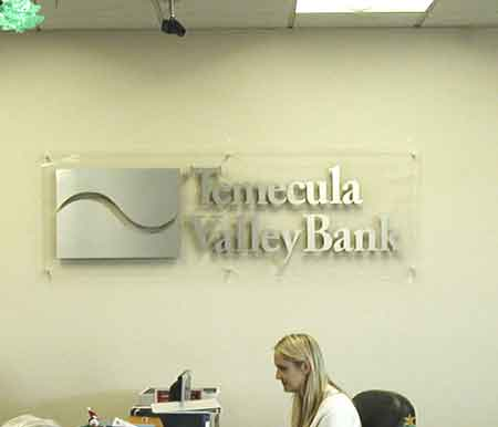 Aahs signs and Graphics brushed metal face text and logo on acrylic with standoff_lobby sign