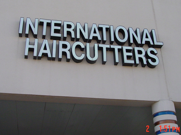 International Haircutters Storefront Sign
