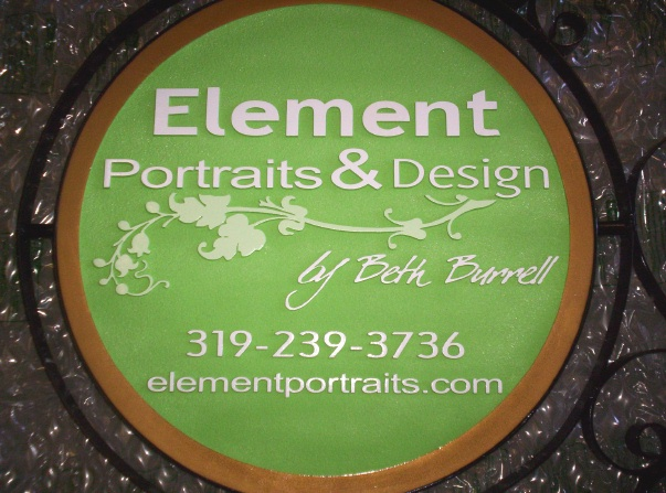 "SA28410A -  Carved HDU  Sign for the ""Elements Portrait & Design""  Studio, with Round Iron Frame"