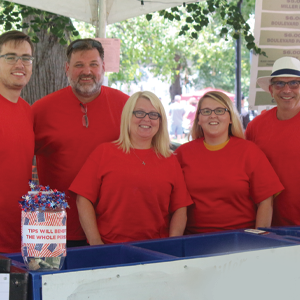 Group of volunteers in red shirts at Main Street Music Festival