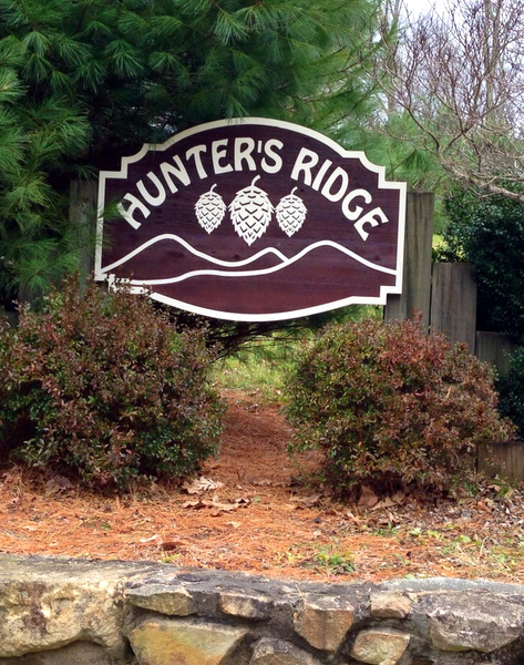 "M22118 - Carved and Sandblasted Cedar Wood Sign, ""Hunter's Ridge"", Shown Installed on a Fence"