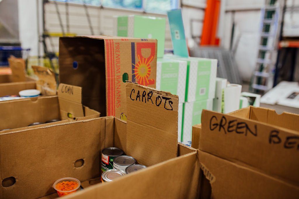 "Food sorting boxes. Reads ""Corn, Carrots, Green."""