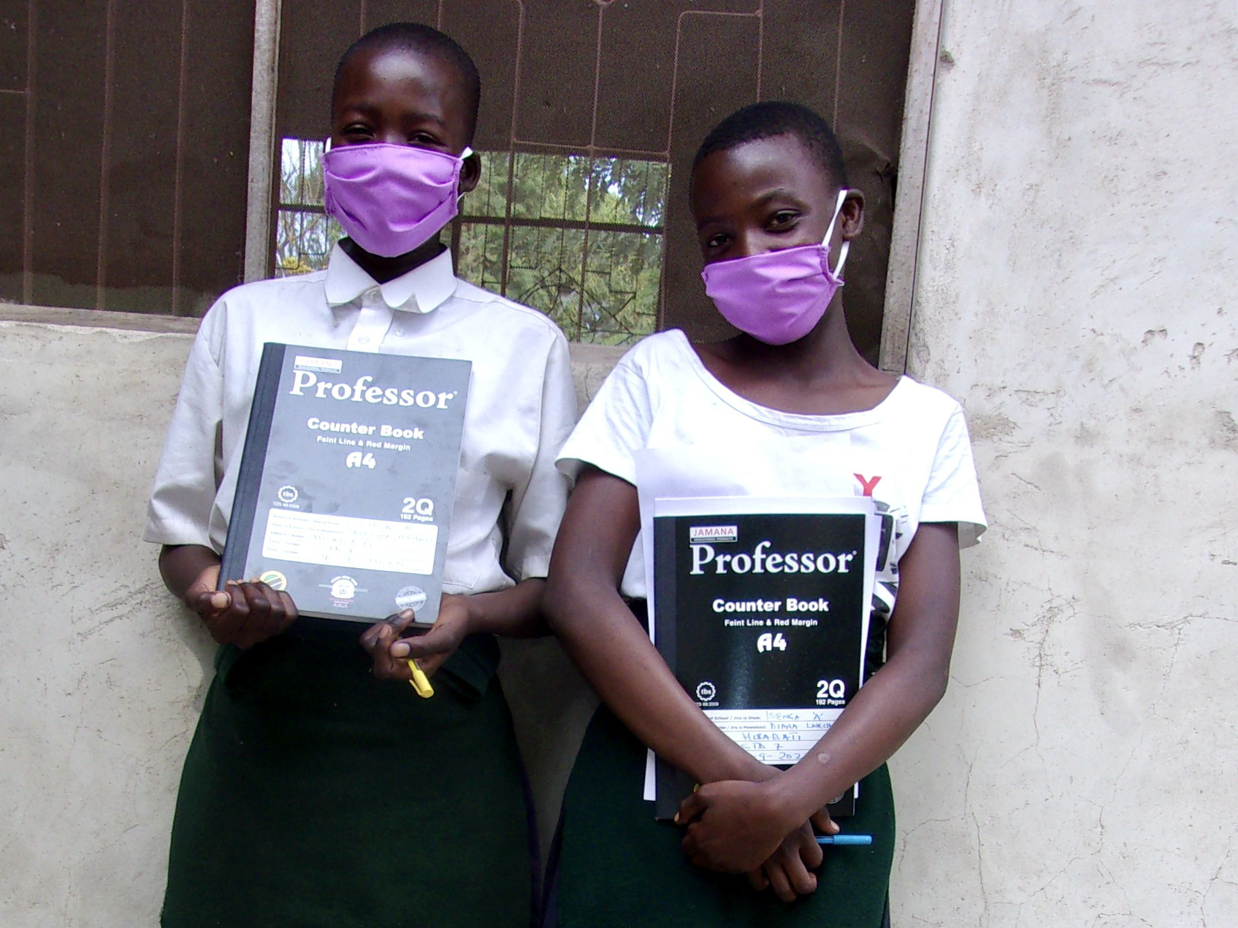 Tanzanian students return to school with masks.