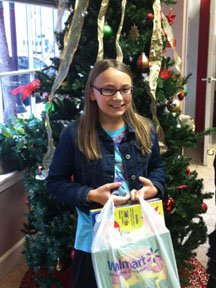 10-year-old girl donates Christmas gifts to Pathways