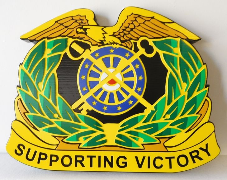 "MP-2040 - Carved Plaque of the Crest of Quartermaster Corps,US Army, with Motto ""Supporting Victory"""