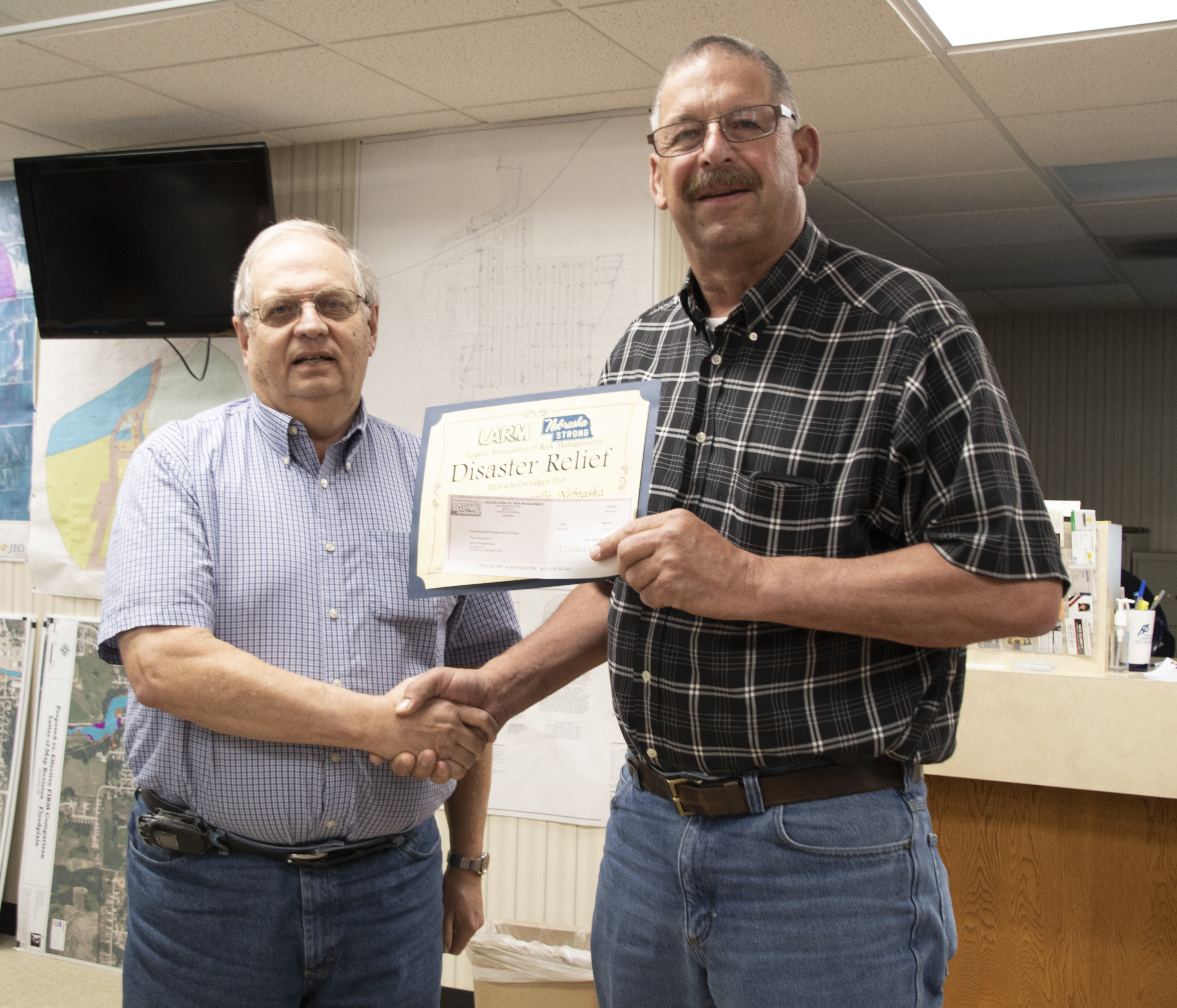 City of Louisville receives disaster funds from LARM