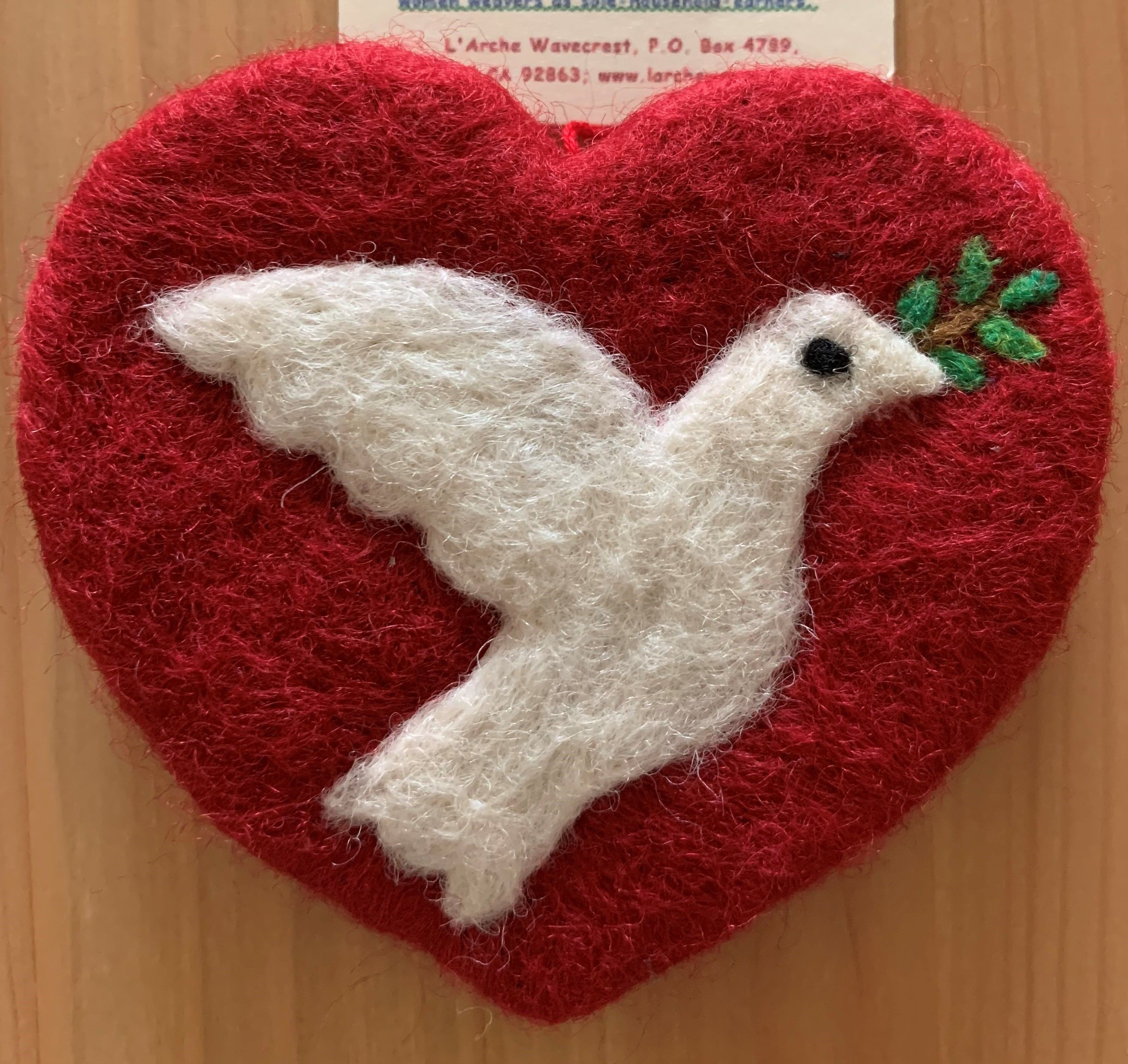 A felt heart-shaped tree ornament, crafted by Guatemalan women