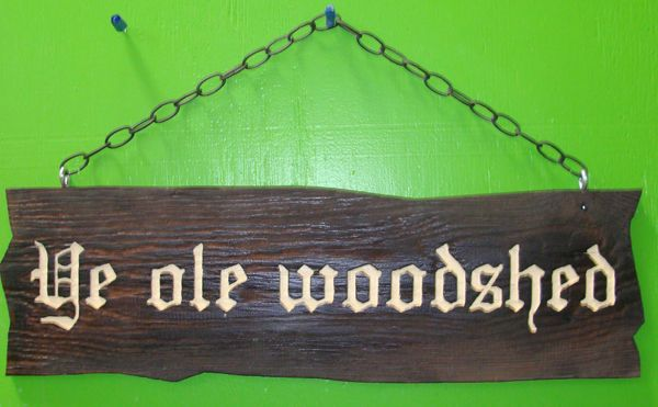 """O24953 - Rustic Carved Wood Sign with Chain Hanger """"Ye Ole Woodshed"""""""