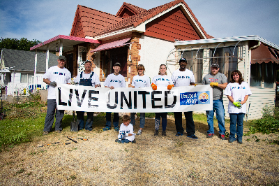 Group of volunteers holding a Live United sign