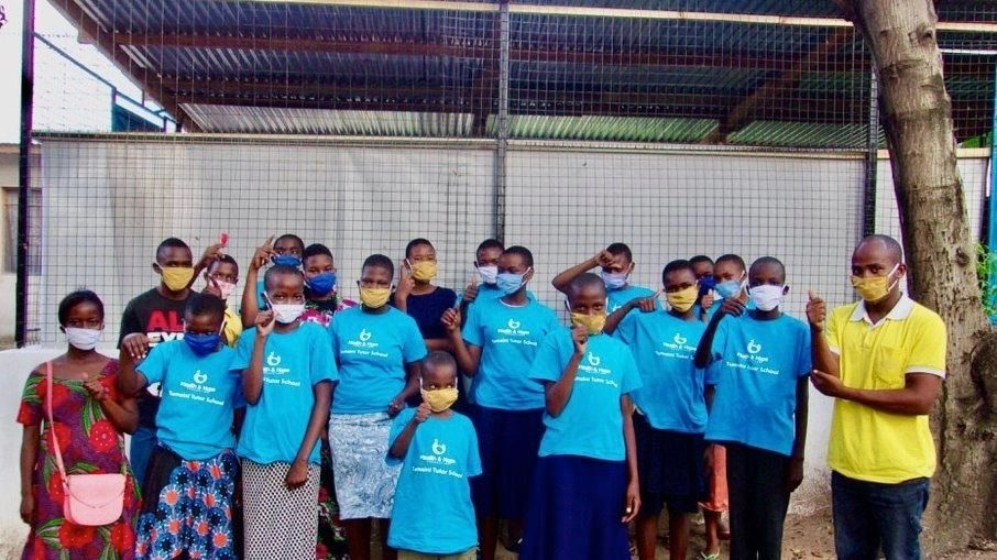 Group of people wearing masking and thanking volunteers for their work.