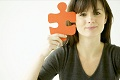 Brunette Woman with Puzzle Piece