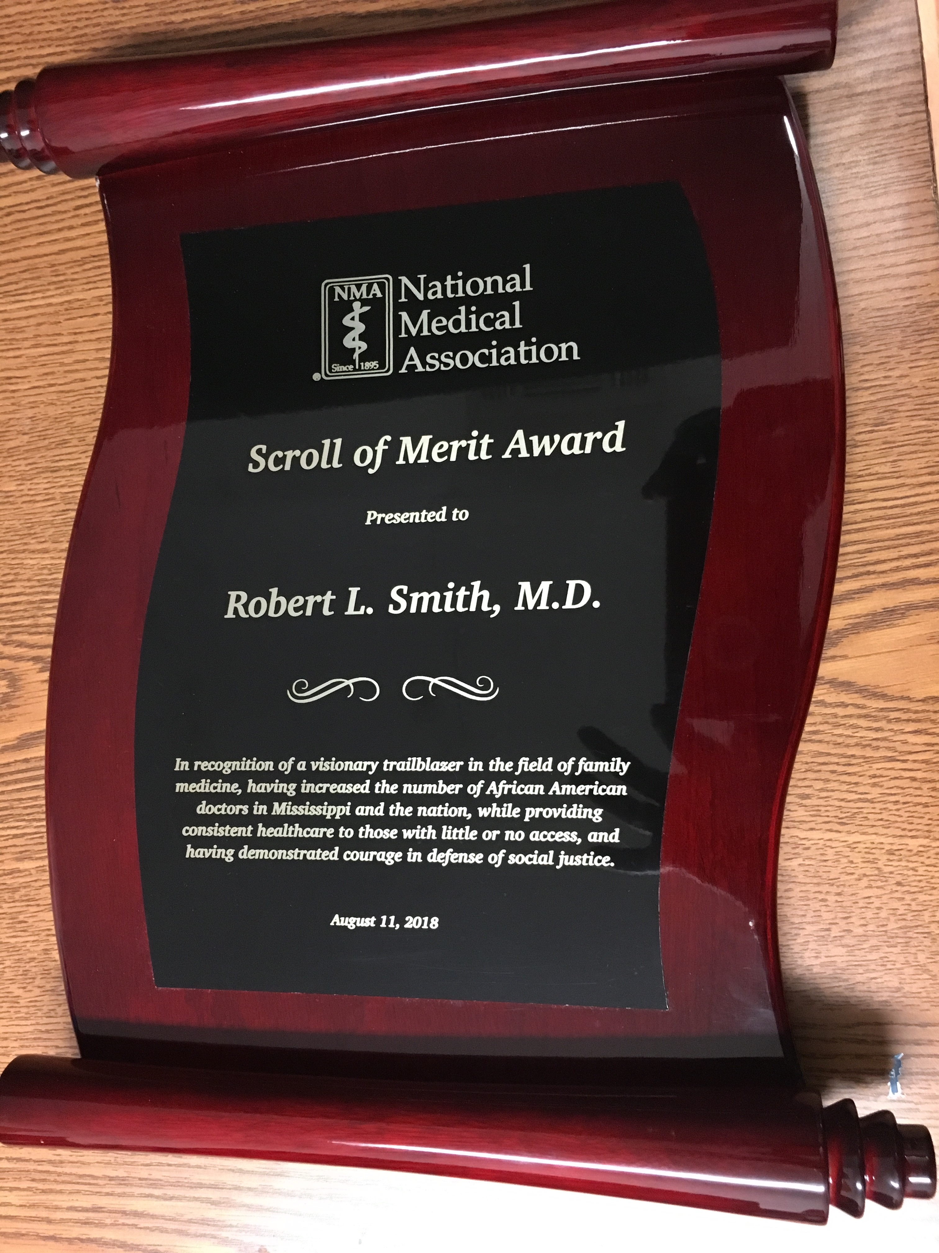 DR. ROBERT SMITH, CLASS OF 1961, RECEIVES NMA SCROLL OF MERIT AWARD.