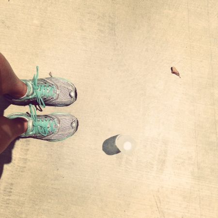 Photo from Elise's Instagram showing her sneakered feet and a bottle of water from a top view.