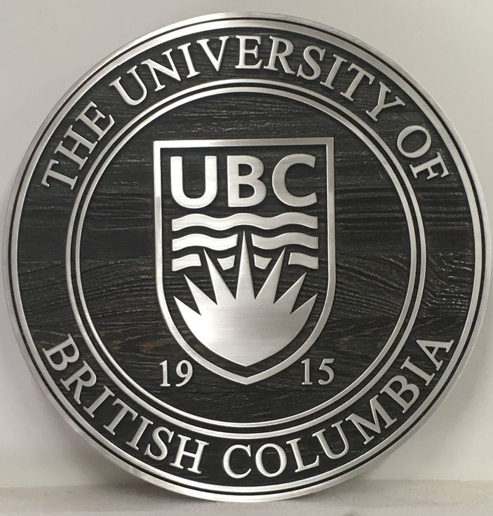 Y34311 - Aluminum and Cedar Wood  Wall Plaque of the  Seal of the University of British Columbia