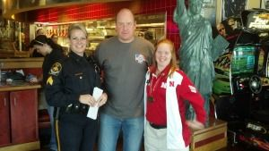 Local Law Enforcement Trade in Handcuffs for Aprons to Support our Athletes!