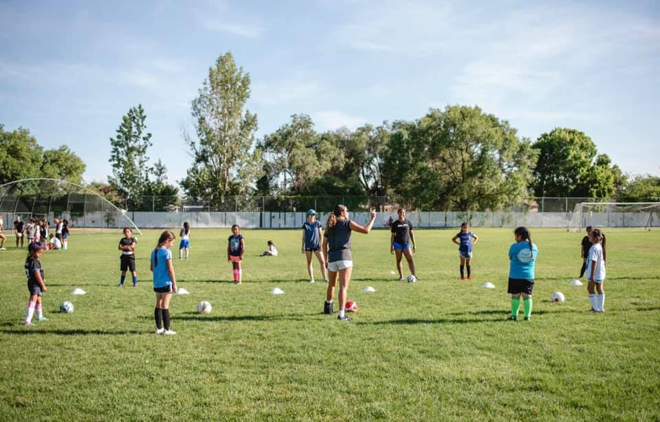 Soccer as an equalizer: Partnering with the Utah Royals Players and Hidden Gems to provide opportunities for UDA girls