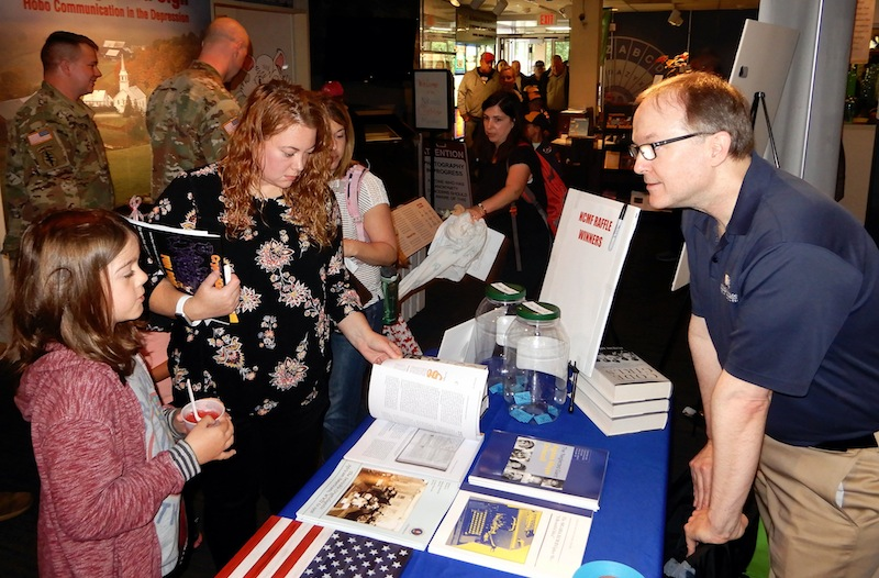Visitors to the NCMF Table