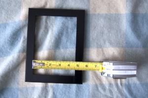 DIY framed shelves measuring the frame