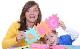 Childcare Provider Teaching Child