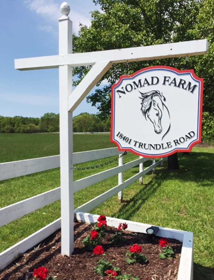 """P25057 - -Carved Entrance and Address Sign  for """"Nomad Farm""""  Hung from a Wood Beam Supported by a Wood Post"""