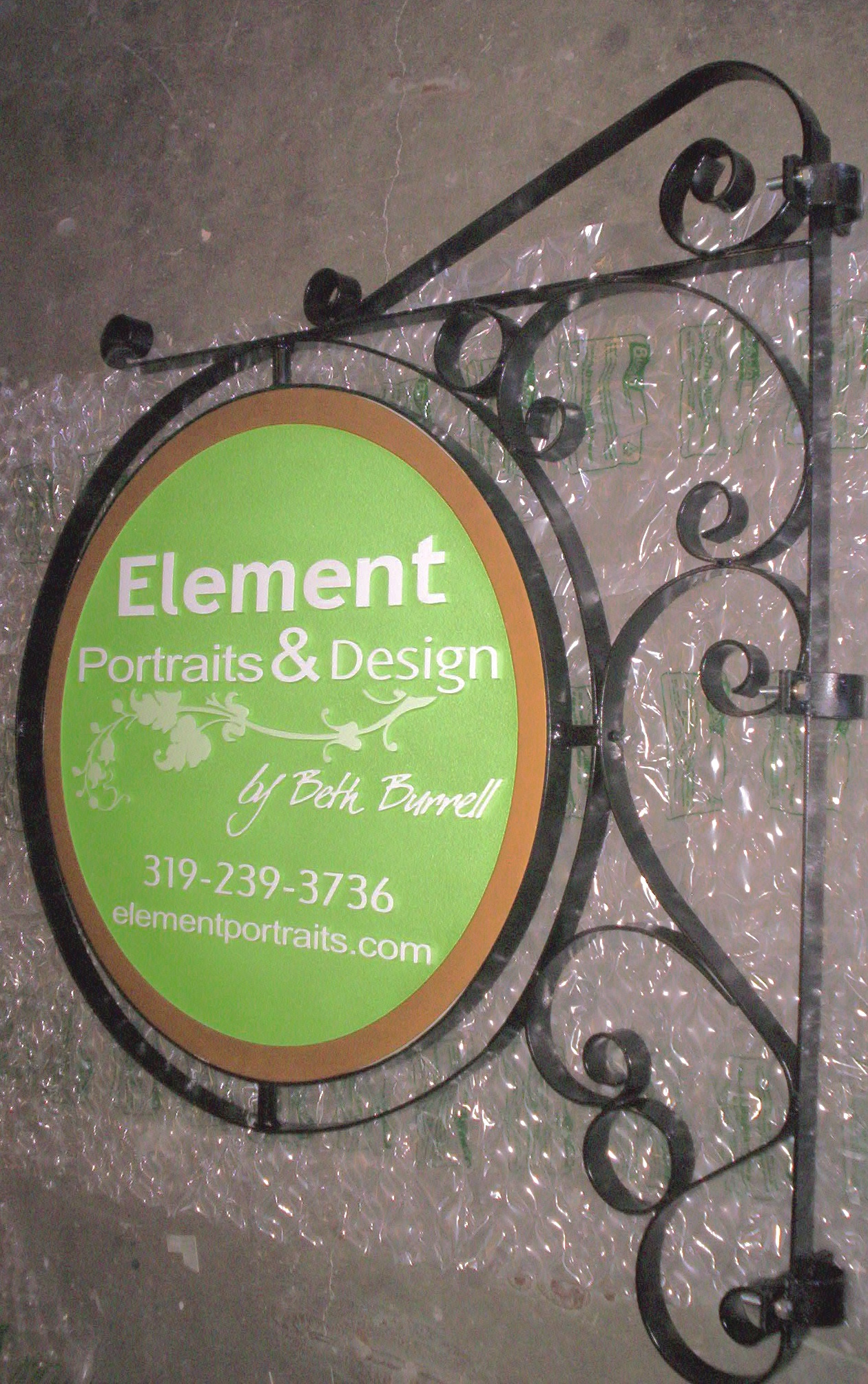 "SA28410 - Carved HDU  Sign for the ""Elements Portrait & Design""  Studio, with Scroll Bracket for Wall Mount"