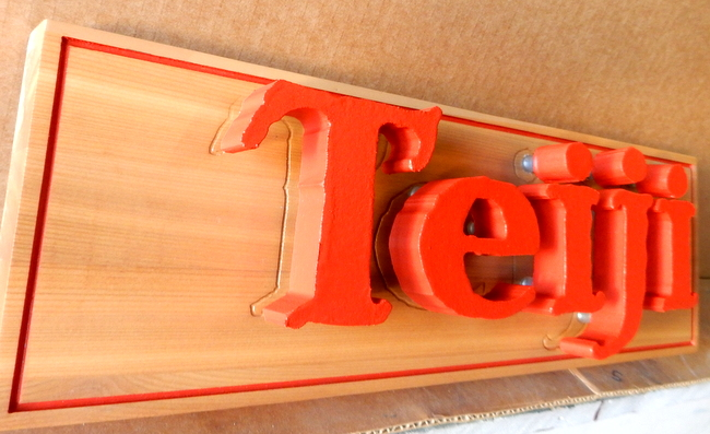 """SA28782 - Close-Up View of """"Teiji"""" or """"People""""Cut-Out Letters Sign"""