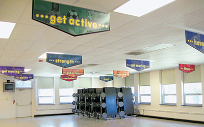 School café with 11 banners hanging from ceiling, custom banners, encourage healthy lifestyles in kids