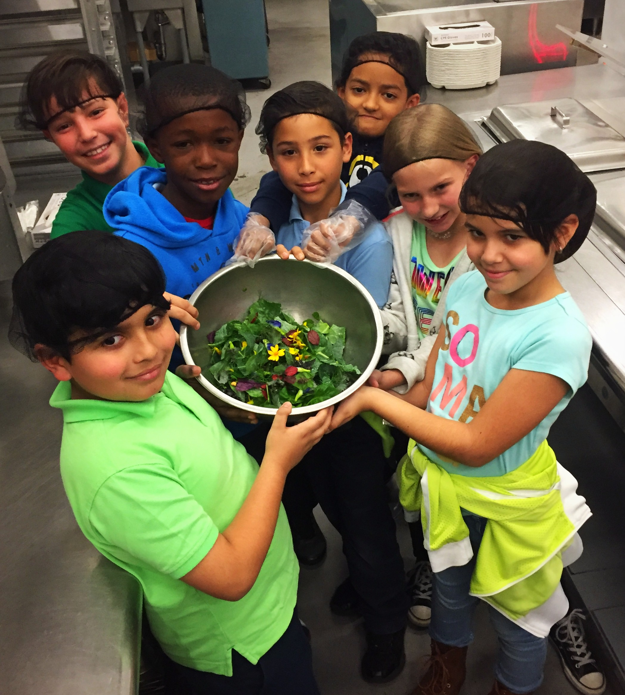 Students proudly display their garden salad