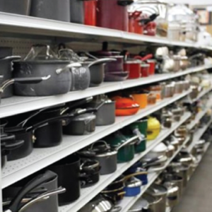 A rack filled with pots and pans at Goodwill.