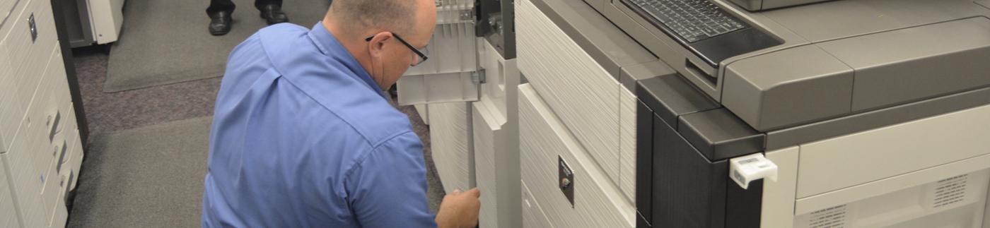 Eakes Service Technician Working on Copier