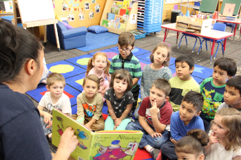 Preschool children listening to a story