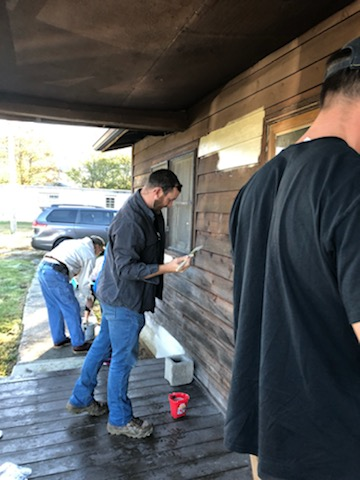 Members from the North Georgia Council of the Greater Chattanooga Association of Realtors helped us paint the exterior of a home we are currently repairing through Re-Habitat