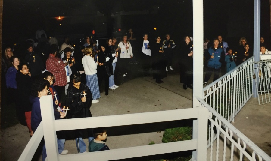 An outdoor Candlelight Vigil during Domestic Violence Awareness Month.