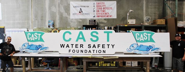 S28139 - Large Carved and Sandblasted Wood Grain Sign for the the Cast Water Safety Foundation, with Otter Logo as Artwork