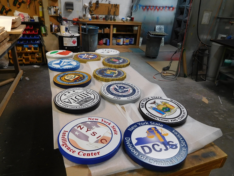 W32600 - Photo of Some of Our Wall Plaques Near Completion in Our Paint Shop