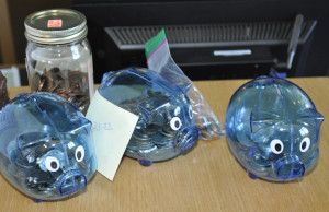 Blue piggy banks on a desk
