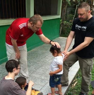 Pastor blessing child
